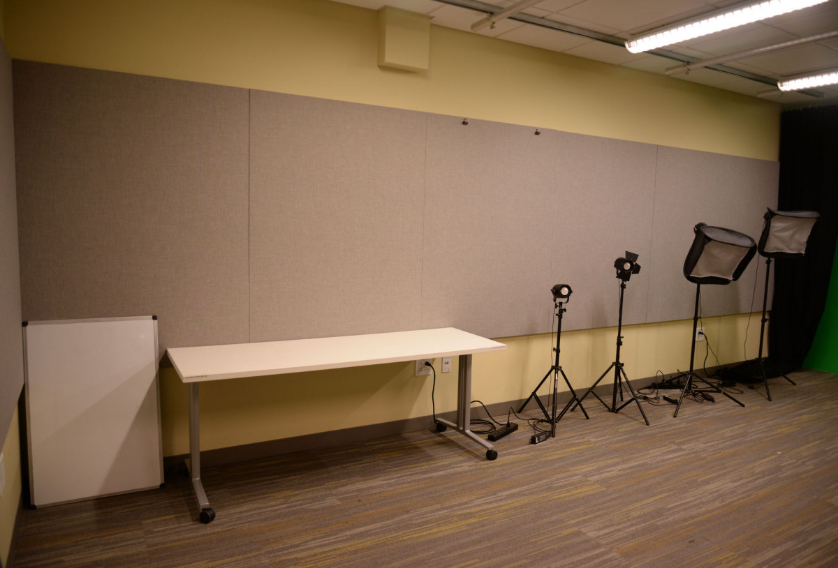 DMC video studio has a white board and a table on casters.