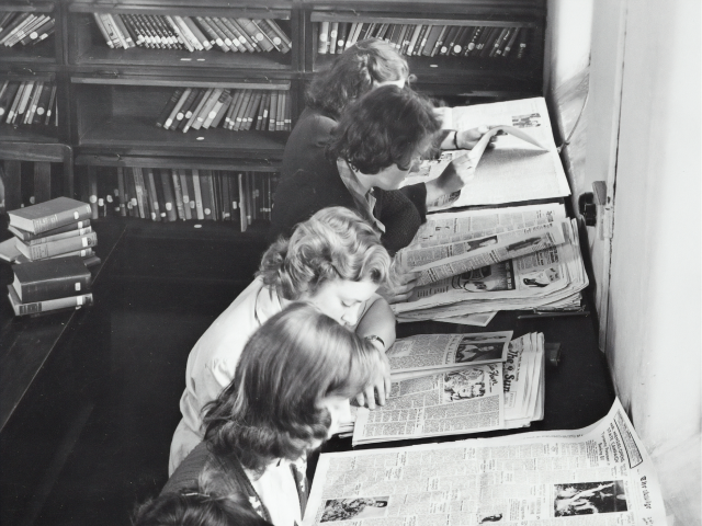 ladies reading newspapers